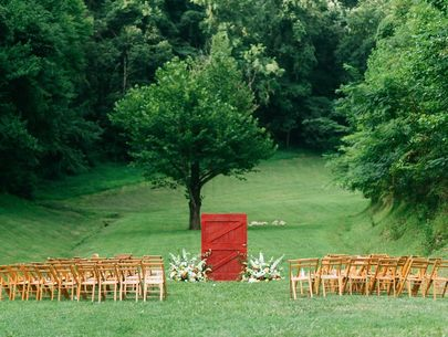 Red Door sets the stage for this outdoor barn wedding near the Great Smoky Mountains
